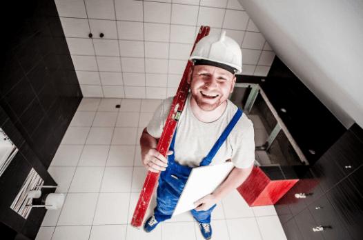 smiling tiling expert afte tile installation