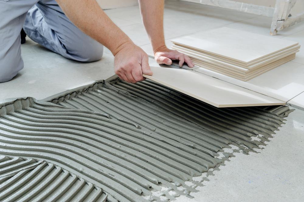 expert tilers in newcastle installing big sized white tiles